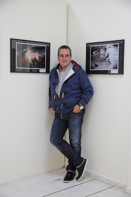 "Nikos Basias with the two photos that have distinguished in 6th Panhellenic photo competition ""Dimitris Letsios"""